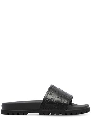 GG EMBOSSED LEATHER SLIDE SANDALS