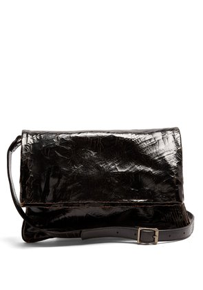 North South cracked-leather messenger bag