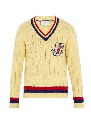 Crest-appliqué cable-knit wool sweater