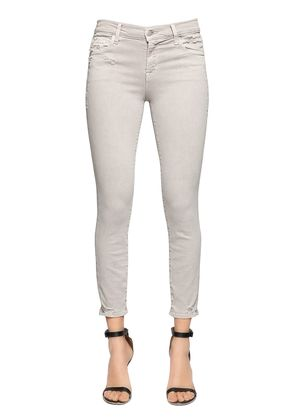 DESTROYED MID RISE CAPRI SKINNY JEANS