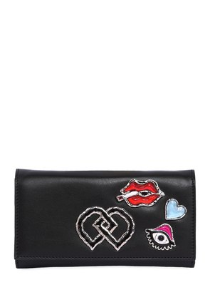 LEATHER CLUTCH W/ APPLIQUÉS