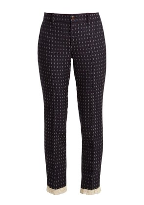 Geometric-embroidered wool-twill trousers
