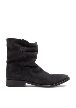 Distressed-effect leather boots