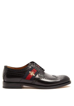 Web-panelled leather brogues