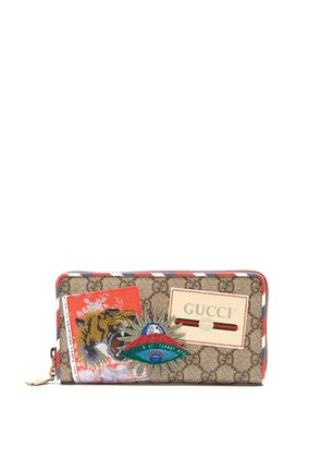 GG Supreme logo and spaceship-patch wallet