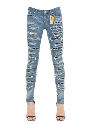 SKINNY DESTROYED WASHED DENIM JEANS