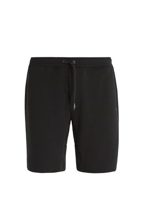 Tech mid-rise track shorts