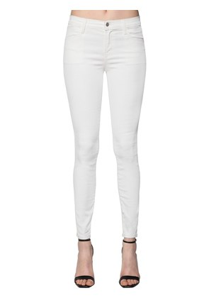 SUPER SKINNY COATED COTTON DENIM JEANS