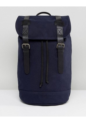 ASOS DESIGN backpack in organic cotton in navy with real leather trims - Navy