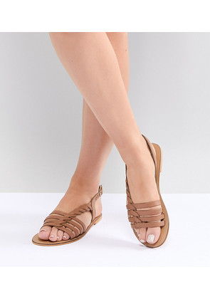 b7ef25a1ebc6 ASOS DESIGN Wide Fit Flattered leather plaited t-bar flat sandals - Tan
