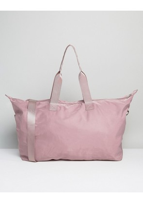 ASOS DESIGN slouchy holdall - Pink