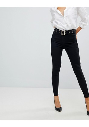 ASOS DESIGN Ridley high waist skinny jeans in clean black with extended belt detail and back seam - Black