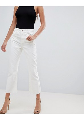 ASOS DESIGN Egerton rigid cropped flare in chalk white cord in raw hem - White