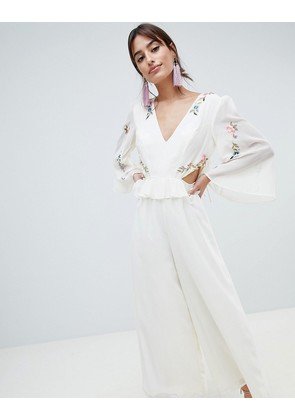 ASOS DESIGN cut out jumpsuit with soft ruffles and embroidery - Cream