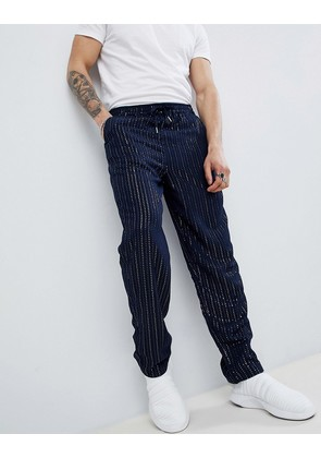 ASOS DESIGN skater trousers with sequins stripes in navy - Navy