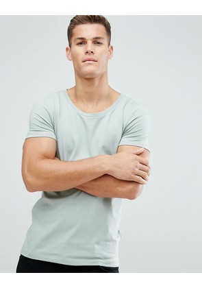 ASOS DESIGN muscle fit t-shirt with scoop neck in green - Grasshopper