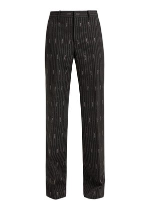 Logo wool and silk-blend jacquard trousers