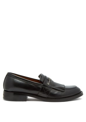 Metal arrow fringed leather loafers