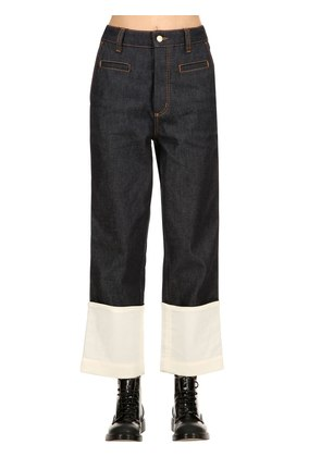 DENIM JEANS WITH CONTRASTING HEM