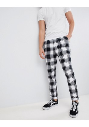 ASOS DESIGN tapered trousers in monochrome flannel check - Black