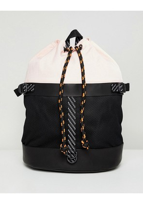ASOS DESIGN duffel backpack in pink and black mesh with internal laptop pouch - Black