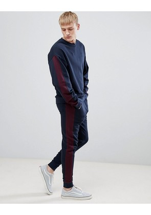 ASOS DESIGN tracksuit oversized sweatshirt/skinny joggers with side stripe in navy and burgundy - Navy/ kidney