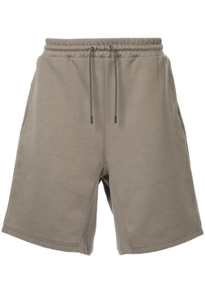 Undercover Human Control System shorts - Brown