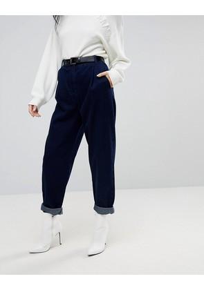 ASOS DESIGN tapered jeans with curved seams and belt in indigo wash - Indigo