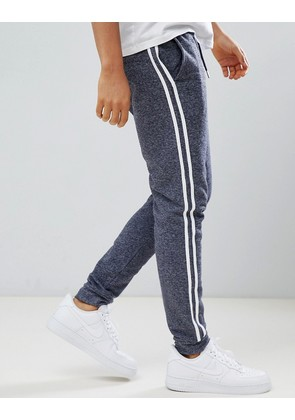 ASOS DESIGN skinny joggers in navy interest fabric with side stripe - Navy