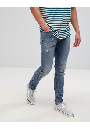 ASOS DESIGN skinny jeans in dark wash blue with abrasions - Dark wash blue
