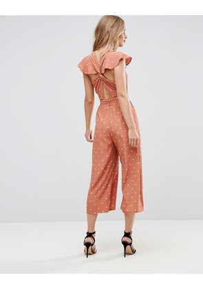 ASOS Jumpsuit with Twist Back and Frill Detail in Spot Print - Rust spot