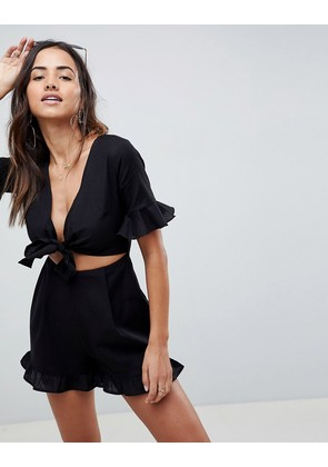 ASOS DESIGN playsuit with cut out and tie detail in linen - Black