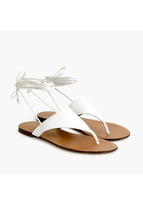 Ankle-tie thong sandals in leather