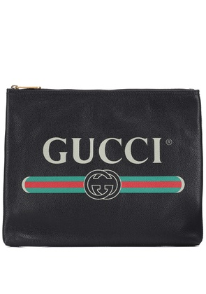 Gucci Print leather pouch