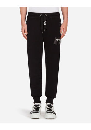 Dolce & Gabbana Trousers - COTTON JOGGING PANTS WITH PATCHES BLACK