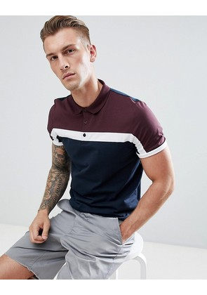 ASOS DESIGN polo shirt with colour block in navy - Shaken not stirred