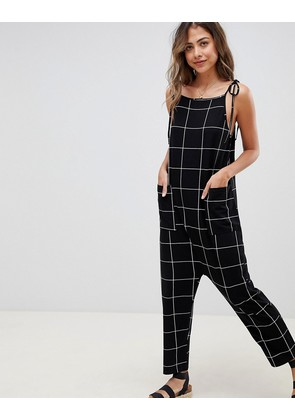 ASOS DESIGN jersey minimal jumpsuit with ties in check - Multi