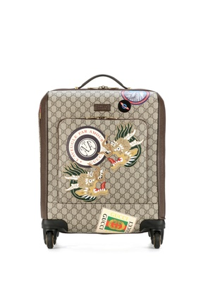 Leather-trimmed carry-on suitcase