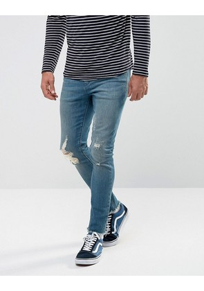 ASOS Super Skinny Jeans In Dark Wash Blue With Rips And Hem Detail - Dark wash blue