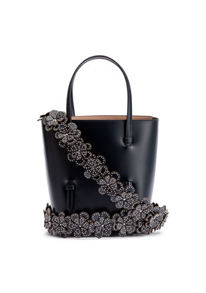 Navy leather tote with studded floral strap