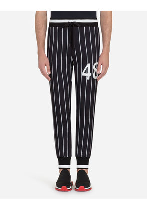 Dolce & Gabbana Trousers - PRINTED COTTON JOGGING PANTS WITH PATCH MULTICOLOR