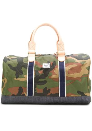 Herschel Supply Co. Green camouflage large holdall