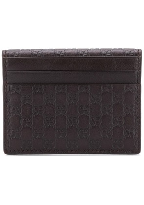 Gucci embossed GG card holder - Brown