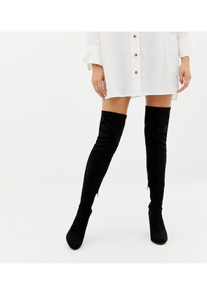 a872ab88fc9 ASOS DESIGN x LaQuan Smith padded over the knee heeled boot in camo ...