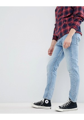 Jack & Jones Tapered Fit Jeans In Washed Denim