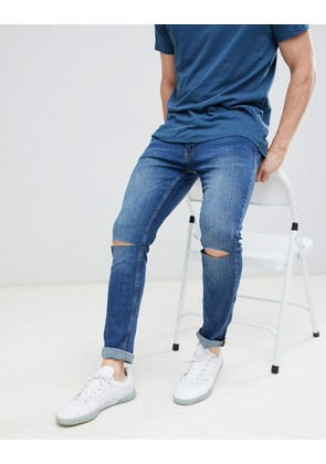 Jack & Jones Skinny Jeans With Rip Knee In Mid Blue Denim