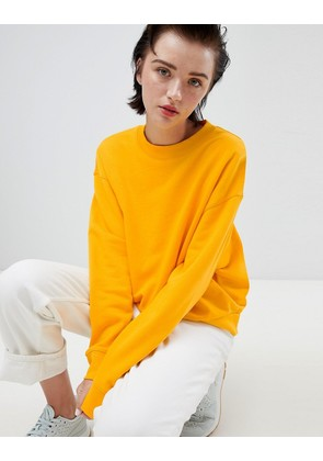 Weekday cropped sweatshirt in warm yellow